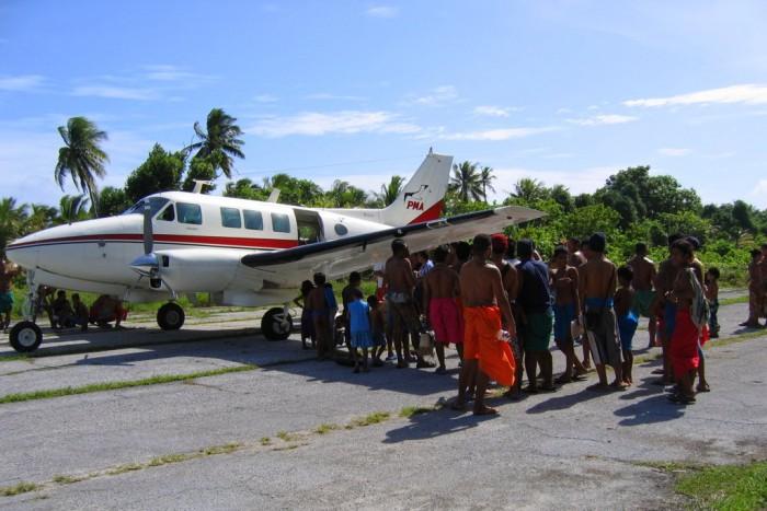 Yap_Woleai_PMA_Aircraft_Villagers