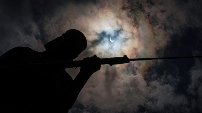 "A picture taken on September 1, 2016 shows the moon moving to cover the sun for a annular solar eclipse behind the ""Askari monument"" in Dar es Salaam. Stargazers in south and central Africa are treated to a spectacular solar eclipse on September 1, 2016 when the Moon wanders into view to make the Sun appear as a ""ring of fire"", astronomers say. The phenomenon, known as an annular solar eclipse, happens when there is a near-perfect alignment of the Earth, Moon and Sun. / AFP PHOTO / DANIEL HAYDUK"
